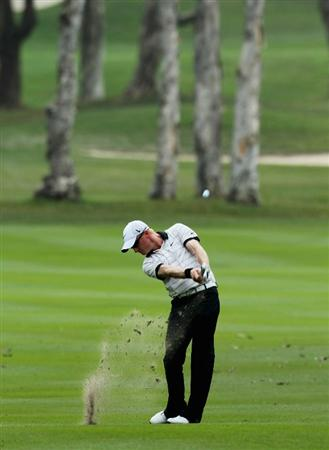 HONG KONG - NOVEMBER 21:  Simon Dyson of England in action during day four of the UBS Hong Kong Open at The Hong Kong Golf Club on November 21, 2010 in Hong Kong.  (Photo by Stanley Chou/Getty Images)