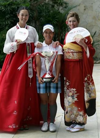 SINGAPORE - FEBRUARY 22: Michelle Wie of the USA, Ai Miyazato of Japan and Paula Creamer of the USA in traditional Korean and Japanese dress during a photocall at the Fairmont Hotel prior to the HSBC Women's Champions at Tanah Merah Country Club  on February 22, 2011 in Singapore, Singapore.  (Photo by Ross Kinnaird/Getty Images)