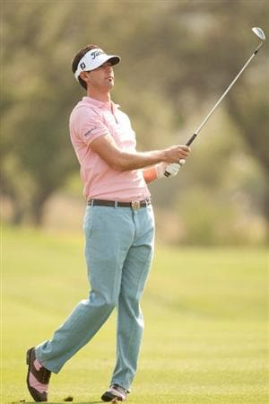 SAN ANTONIO, TX - APRIL 16: Cameron Tringale follows through on an approach shot during the third round of the Valero Texas Open at the AT&T Oaks Course at TPC San Antonio on April 16, 2011 in San Antonio, Texas. (Photo by Darren Carroll/Getty Images)