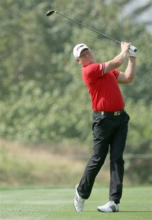 DUBAI, UNITED ARAB EMIRATES - JANUARY 29:  Peter Hedblom of Sweden hits his second shot at the par 5, 13th hole during the first round of the 2009 Dubai Desert Classic on the Majilis Course at the Emirates Golf Club on January 29, 2009 in Dubai, United Arab Emirates  (Photo by David Cannon/Getty Images)