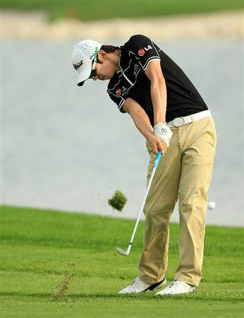 BAHRAIN, BAHRAIN - JANUARY 28:  Seung-yul Noh of South Korea plays his second shot at the 15th hole during the second round of the 2011 Volvo Champions held at the Royal Golf Club on January 28, 2011 in Bahrain, Bahrain.  (Photo by David Cannon/Getty Images)