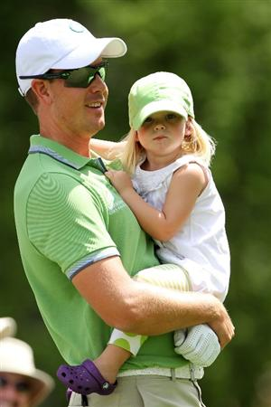 AUGUSTA, GA - APRIL 07:  Henrik Stenson of Sweden waits with his daughter Lisa during the Par 3 Contest prior to the 2010 Masters Tournament at Augusta National Golf Club on April 7, 2010 in Augusta, Georgia.  (Photo by Jamie Squire/Getty Images)