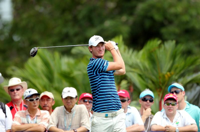 SINGAPORE - NOVEMBER 13: Chris Wood of England watches his tee shot on the 13th hole during the Third Round of the Barclays Singapore Open on November 13, 2010 in Singapore, Singapore.  (Photo by Stanley Chou/Getty Images)