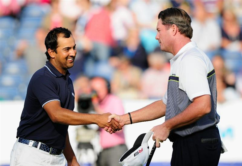 HILVERSUM, NETHERLANDS - SEPTEMBER 11:  Todd Hamilton of USA shakes hands with Shiv Kapur of India on the 18th hole during the third round of  The KLM Open Golf at The Hillversumsche Golf Club on September 11, 2010 in Hilversum, Netherlands.  (Photo by Stuart Franklin/Getty Images)