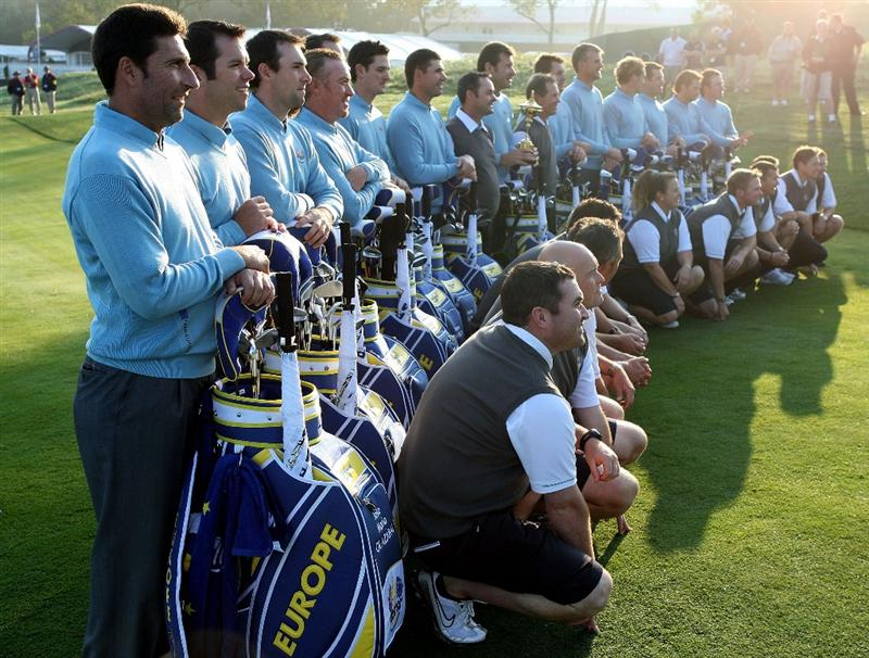 LOUISVILLE, KY - SEPTEMBER 16:  (L-R) Jose Maria Olazabal (assistant captian), Paul Casey, Oliver Wilson, Miguel Angel Jimenez, Soren Hansen, Justin Rose, Padraig Harrington, Nick Faldo (captain), Henrick Stenson, Robert Karlsson, Ian Poulter, Lee Westwood, Sergio Garcia, Graeme McDowell of the European team and their caddies pose for the official team photograph prior to the 2008 Ryder Cup at Valhalla Golf Club of September 16, 2008 in Louisville, Kentucky.  (Photo by Ross Kinnaird/Getty Images)