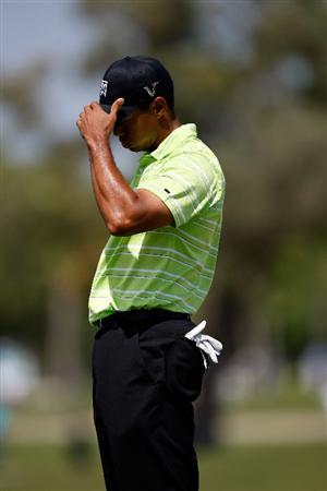 DORAL, FL - MARCH 14:  Tiger Woods reacts after missing a putt on the 6th hole during the third round of the World Golf Championships-CA Championship on March 14, 2009 at the Doral Golf Resort and Spa in Miami, Florida.  (Photo by Jamie Squire/Getty Images)
