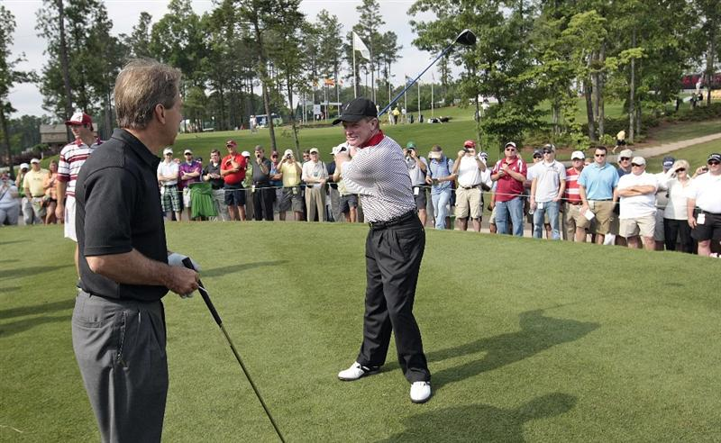 BIRMINGHAM, AL - MAY 14:  Tom Kite (R) talks with Alabama football coach Nick Saban during the Thursday Pro-AM of the Regions Charity Classic at the Robert Trent Jones Golf Trail at Ross Bridge on May 14, 2009  in Birmingham, Alabama. (Photo by Dave Martin/Getty Images)
