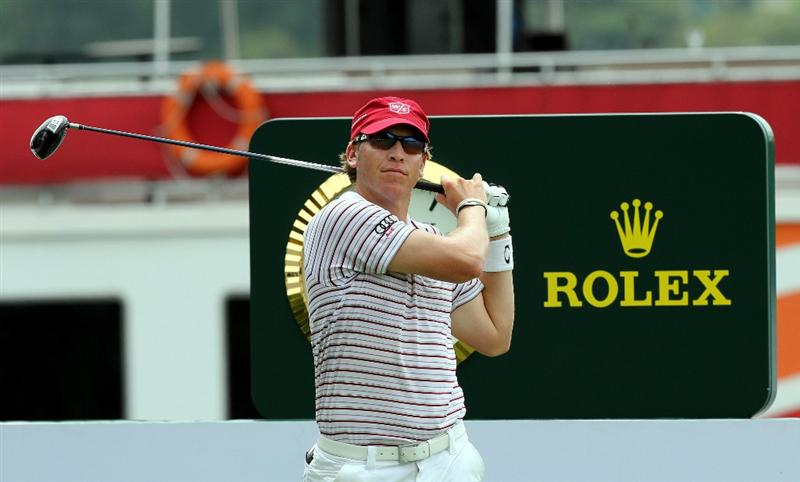 KUALA LUMPUR, MALAYSIA - OCTOBER 30: Ricky Barnes of USA watches his tee shot on the 11th hole during day three of the CIMB Asia Pacific Classic at The MINES Resort & Golf Club on October 30, 2010 in Kuala Lumpur, Malaysia. (Photo by Stanley Chou/Getty Images)
