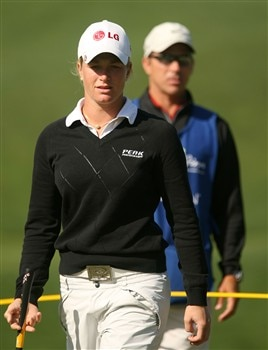 REUNION, FLORIDA - APRIL 17:  Suzann Pettersen (L) of Norway waits with her caddie Greg Johnston on the second green during the first round of the Ginn Open at Reunion Resort April 17, 2008 in Reunion, Florida.  (Photo by Scott Halleran/Getty Images)