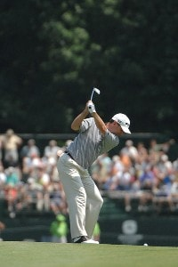 SILVIS, IL - JULY 14:  Kevin Sutherland hits his approach shot into the 9th hole during the third round of The John Deere Classic at the TPC Deere Run on July 14, 2007 in Silvis, Illinois.   (Photo by Marc Feldman/WireImage) *** Local Caption *** Kevin Sutherland PGA TOUR - 2007 John Deere Classic - Third RoundPhoto by Marc Feldman/WireImage) *** Local Caption *** Kevin Sutherland