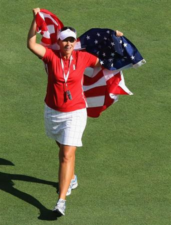 SUGAR GROVE, IL - AUGUST 23:  Angela Stanford of the U.S. Team celebrates on the 18th fairway after the match was won in the Sunday singles matches at the 2009 Solheim Cup Matches at the Rich Harvest Farms Golf Club on August 23, 2009 in Sugar Grove, Ilinois (Photo by David Cannon/Getty Images)