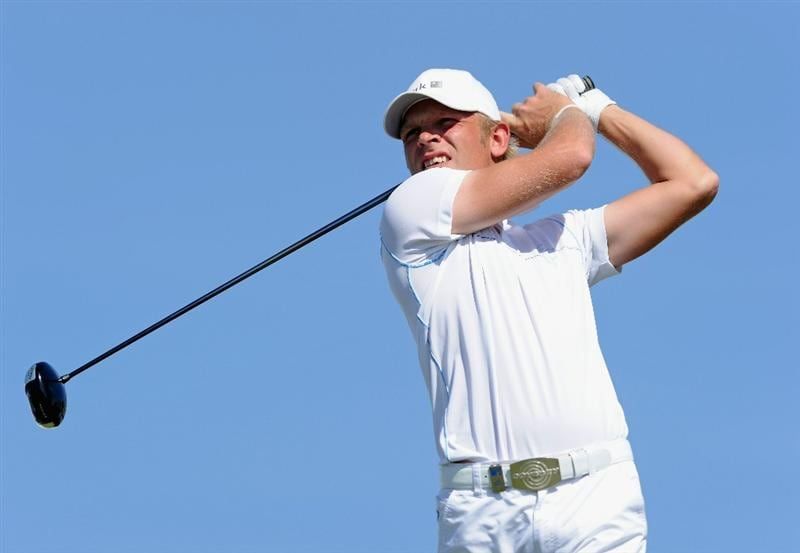 VILAMOURA, PORTUGAL - OCTOBER 17:  Jeppe Huldahl of Denmark plays his tee shot on the first hole during the final round of the Portugal Masters at the Oceanico Victoria Golf Course on October 17, 2010 in Vilamoura, Portugal.  (Photo by Stuart Franklin/Getty Images)