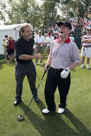 BIRMINGHAM, AL - MAY 14:  Golfer Tom Kite (R) laughs with Alabama football coach Nick Saban as they stand on the fist tee during the Thursday Pro-AM of the Regions Charity Classic at the Robert Trent Jones Golf Trail at Ross Bridge on May 14, 2009  in Birmingham, Alabama. (Photo by Dave Martin/Getty Images)