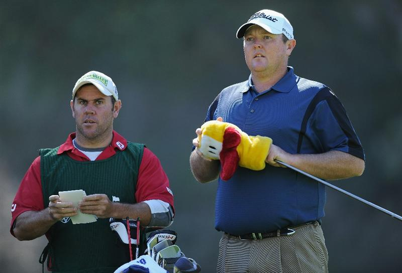 PACIFIC PALISADES, CA - FEBRUARY 17:  Jarrod Lyle of Australia and caddie ponder his tee shot on the nineth hole during the first round of the Northern Trust Open at Riviera Country Club on February 17, 2011 in Pacific Palisades, California.  (Photo by Stuart Franklin/Getty Images)