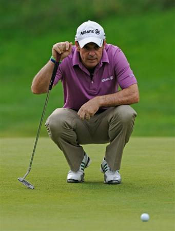 PARIS - SEPTEMBER 23:  Paul McGinley of Ireland lines up his putt on the second hole during the first round of the Vivendi cup at Golf de Joyenval on September 22, 2010 in Chambourcy, near Paris, France.  (Photo by Stuart Franklin/Getty Images)