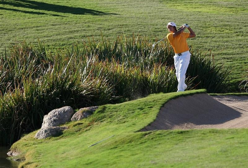 SCOTTSDALE, AZ - OCTOBER 25: Rickie Fowler hits his second shot from the rough on the 18th hole during the fourth round of the Frys.com Open at Grayhawk Golf Club on October 25, 2009 in Scottsdale, Arizona. (Photo by Christian Petersen/Getty Images)