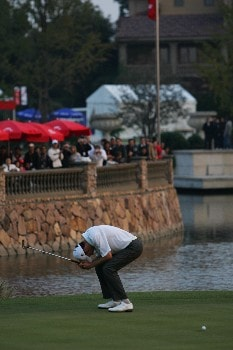 SHANGHAI, CHINA - NOVEMBER 11:  Ross Fisher of England looks dejected on the 18th green during the playoff during the final day of the HSBC Champions at the Sheshan Golf Club on November 11, 2007 in Shanghai, China.  (Photo by Andrew Wong/Getty Images)