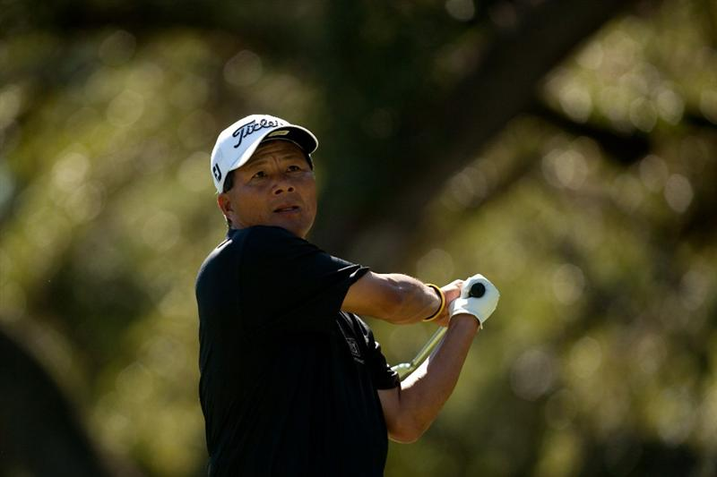 SAN ANTONIO, TX - OCTOBER 31: Chien Soon Lu of Taiwan follows through on a tee shot during the final round of the AT&T Championship at Oak Hills Country Club on October 31, 2010 in San Antonio, Texas. (Photo by Darren Carroll/Getty Images)