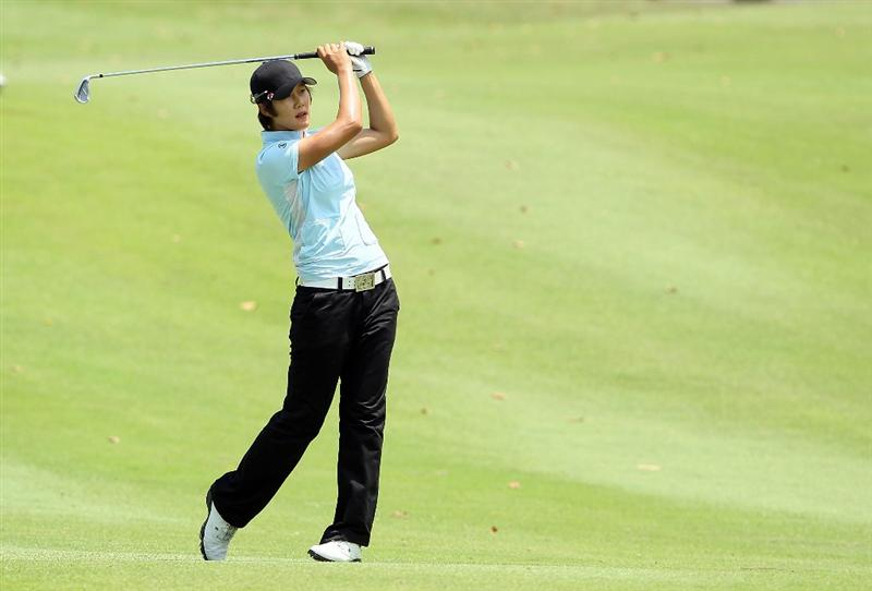 SINGAPORE - FEBRUARY 26:  Song-Hee Kim of South Korea hits her second shot on the 9th hole during the second round of the HSBC Women's Champions at Tanah Merah Country Club on February 26, 2010 in Singapore, Singapore.  (Photo by Andy Lyons/Getty Images)