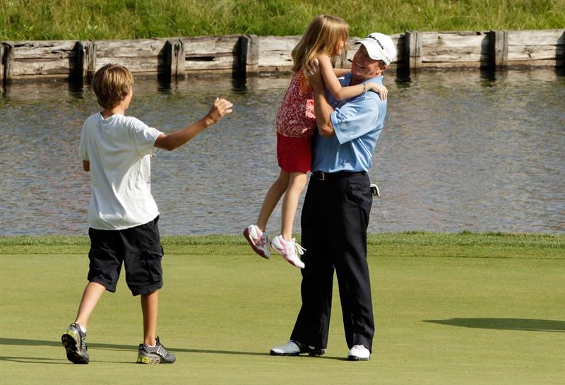 CARMEL, IN - AUGUST 02:  Fred Funk of the USA is greeted by his kids on the 18th green after winning the 2009 U.S. Senior Open on August 2, 2009 at Crooked Stick Golf Club in Carmel, Indiana.  (Photo by Jamie Squire/Getty Images)