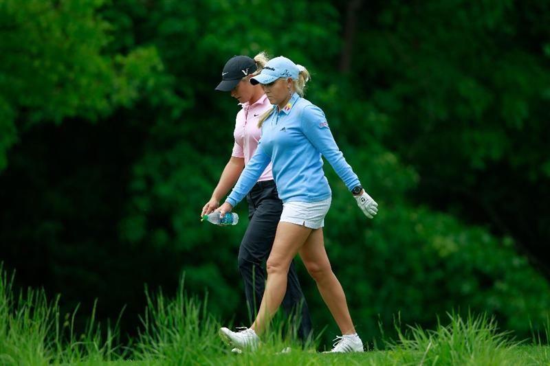 GLADSTONE, NJ - MAY 19:  Suzann Pettersen of Norway (L) walks down the sixth fairway with her opponent Natalie Gulibis during round one of the Sybase Match Play Championship at Hamilton Farm Golf Club on May 19, 2011 in Gladstone, New Jersey.  (Photo by Chris Trotman/Getty Images)