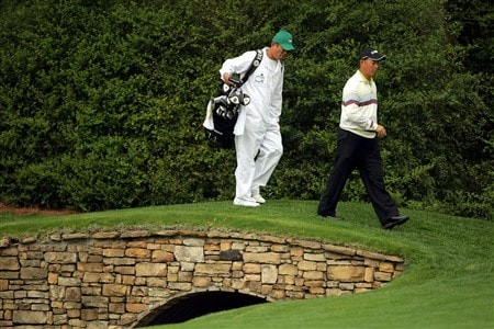 AUGUSTA, GA - APRIL 08:  Toru Taniguchi of Japan crosses a bridge with his caddie during the second day of practice prior to the start of the 2008 Masters Tournament at Augusta National Golf Club on April 8, 2008 in Augusta, Georgia.  (Photo by Harry How/Getty Images)