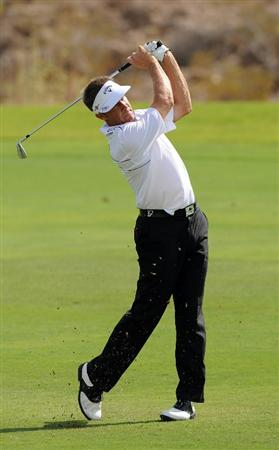 LAS VEGAS, NV - OCTOBER 21: Stuart Appleby of Australia hits his approach shot on the 18th hole during the first round of the Justin Timberlake Shriners Hospitals for Children Open on October 21, 2010 in Las Vegas, Nevada. (Photo by Steve Dykes/Getty Images)