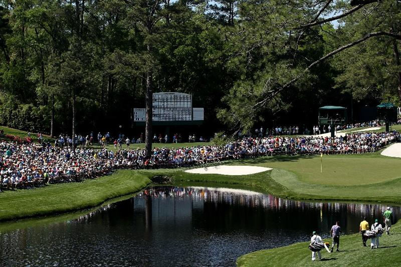 AUGUSTA, GA - APRIL 07:  The group of  Tiger Woods, Robert Allenby of Australia and Graeme McDowell of Northern Ireland approach the 16th green during the first round of the 2011 Masters Tournament at Augusta National Golf Club on April 7, 2011 in Augusta, Georgia.  (Photo by Andrew Redington/Getty Images)