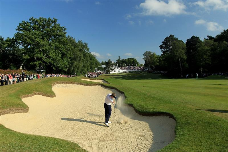 VIRGINIA WATER, ENGLAND - MAY 29:  (EDITORS NOTE: A POLARIZING FILTER WAS USED IN THE CAPTURE OF THIS IMAGE) Luke Donald of England hits from a bunker on the 18th hole during the final round of the BMW PGA Championship  at the Wentworth Club on May 29, 2011 in Virginia Water, England.  (Photo by David Cannon/Getty Images)