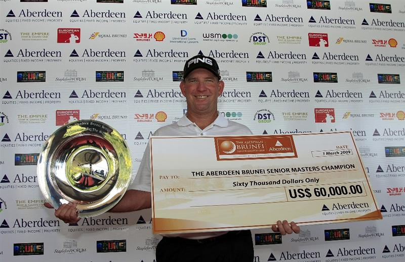 DARUSSALAM BANDAR SERI BEGAWAN, BRUNEI DARUSSALAM - MARCH 01:  Mike Cunning of the US poses with the trophy after the final round of The Aberdeen Brunei Senior Masters presented by The Stapleford Forum played at the Empire Hotel and Country Club on March 1, 2009 in Brunei Darussalam.  (Photo by Phil Inglis/Getty Images)