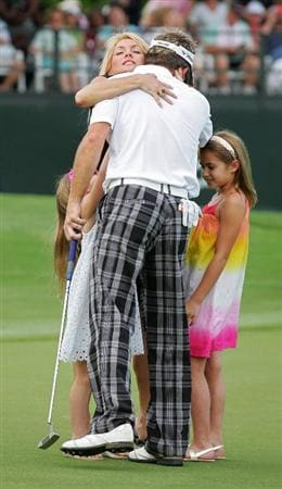 MEMPHIS, TN - JUNE 14:  Brian Gay of the United States celebrates winning on the 18th green with his wife Kimberly and daughters Makinley and Brantley during the final round of the St. Jude Classic at TPC Southwind held on June 14, 2009 in Memphis, Tennessee.  (Photo by Michael Cohen/Getty Images)