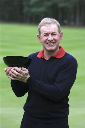 WOBURN, ENGLAND - SEPTEMBER 06:  Tony Johnstone of Zimbabwe poses with the trophy after the final round of the Travis Perkins plc Senior Masters played at The Duke's Course, Woburn Golf Club on September 6, 2009 in Woburn, United Kingdom (Photo by Phil Inglis/Getty Images)