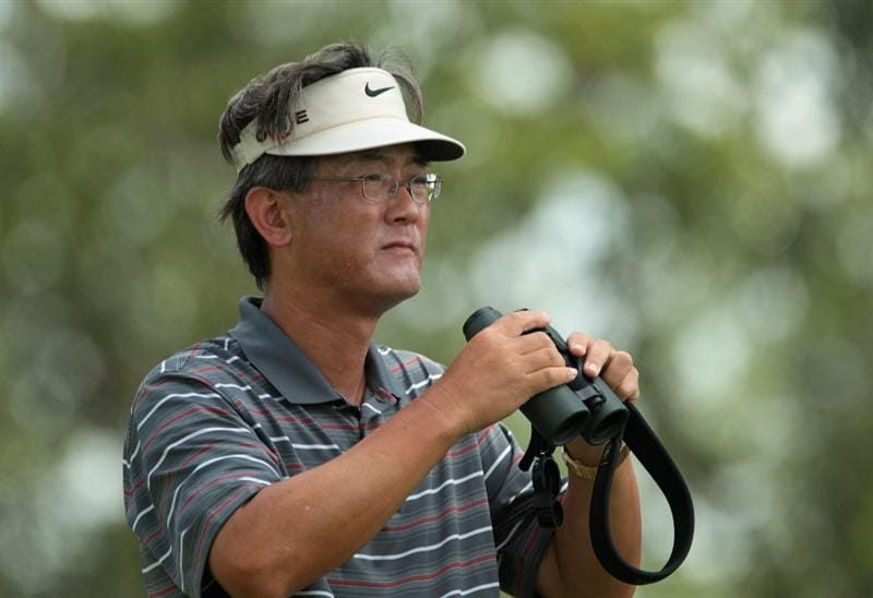 SINGAPORE - FEBRUARY 26:  BJ Wie watches the play of his daughter Michelle Wie during the third round of the HSBC Women's Champions 2011 at the Tanah Merah Country Club on February 26, 2011 in Singapore, Singapore.  (Photo by Scott Halleran/Getty Images)