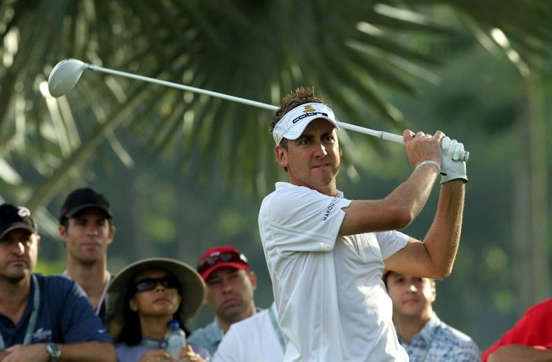 SINGAPORE - NOVEMBER 15: Ian Poulter of England watches his tee shot on the 13th hole during the Final Round of the Barclays Singapore Open held at the Sentosa Golf Club on November 15, 2010 in Singapore, Singapore.  (Photo by Stanley Chou/Getty Images)
