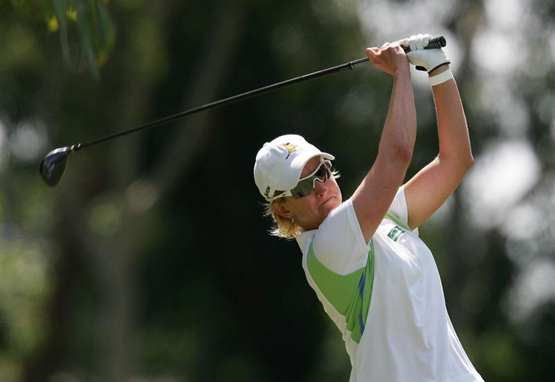 MELBOURNE, AUSTRALIA - MARCH 14:  Karrie Webb of Australia plays an approach shot on the 10th hole during the final round of the 2010 Women's Australian Open at The Commonwealth Golf Club on March 14, 2010 in Melbourne, Australia.  (Photo by Scott Barbour/Getty Images)