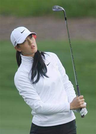 CITY OF INDUSTRY, CA - MARCH 24:  Michelle Wie watches her approach shot on the 11th hole during the first round of the Kia Classic on March 24, 2011 at the Industry Hills Golf Club in the City of Industry, California.  (Photo by Scott Halleran/Getty Images)