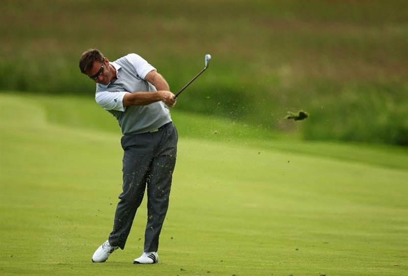 LUSS, SCOTLAND - JULY 09:  Sir Nick Faldo plays into the 18th green during the First Round of The Barclays Scottish Open at Loch Lomond Golf Club on July 09, 2009 in Luss, Scotland.  (Photo by Richard Heathcote/Getty Images)