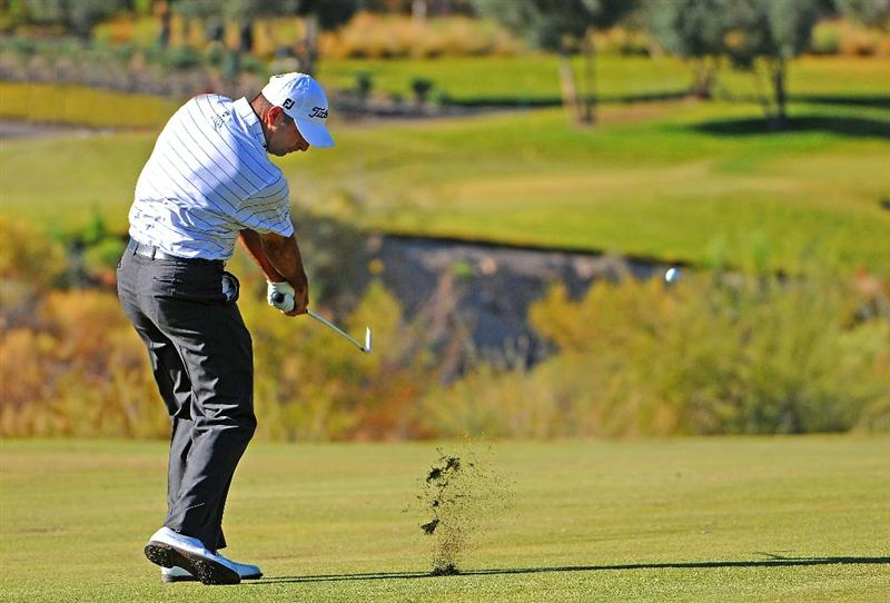 LAS VEGAS - OCTOBER 17:  Marc Turnesa hits his approach shot into the 4th hole during the second round of the Justin Timberlake Shriners Hospitals for Children Open held at the TPC Summerlin on Friday, October 17, 2008 in Las Vegas, Nevada. (Photo by Marc Feldman/Getty Images)