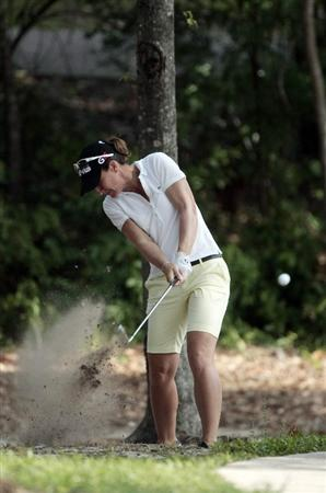 MOBILE, AL - MAY 13: Gwladys Nocera of France hits from the rough on the 10th hole during first round play in Bell Micro LPGA Classic at the Magnolia Grove Golf Course on May 13, 2010 in Mobile, Alabama.  (Photo by Dave Martin/Getty Images)