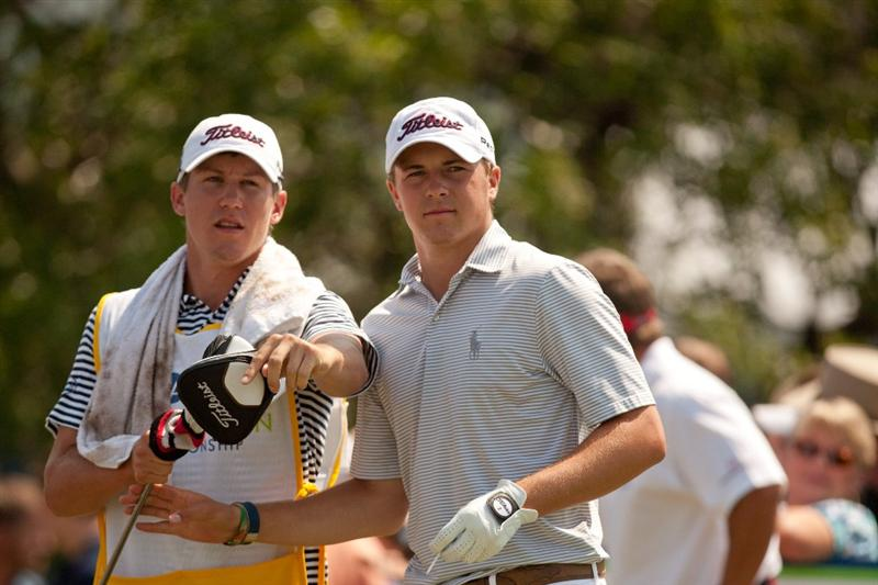IRVING, TX - MAY 27: Jordan Spieth takes a club from caddie Kramer Hickock during the second round of the HP Byron Nelson Championship at TPC Four Seasons at Las Colinas on May 27, 2011 in Irving, Texas. (Photo by Darren Carroll/Getty Images)