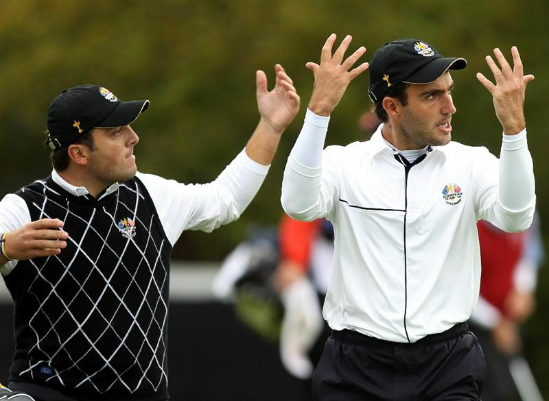 NEWPORT, WALES - OCTOBER 03:  Francesco Molinari of Europe and Edoardo Molinari (R) encourage the crowd on the 15th hole during the  Fourball & Foursome Matches during the 2010 Ryder Cup at the Celtic Manor Resort on October 3, 2010 in Newport, Wales.  (Photo by Ross Kinnaird/Getty Images)