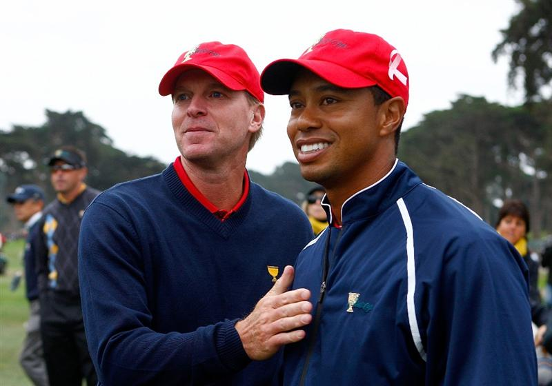 SAN FRANCISCO - OCTOBER 11:  Steve Stricker and Tiger Woods of the USA Team celebrate after the USA defeated the International Team 19.5 to 14.5 to win   The Presidents Cup at Harding Park Golf Course on October 11, 2009 in San Francisco, California.  (Photo by Scott Halleran/Getty Images)