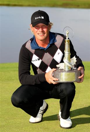 NEWPORT, WALES - JUNE 07:  Jeppe Huldahl of Denmark celebrates victory with the trophy during the final round of the Celtic Manor Wales Open on the 2010 Course at The Celtic Manor Resort on June 7, 2009 in Newport, Wales.  (Photo by Richard Heathcote/Getty Images)