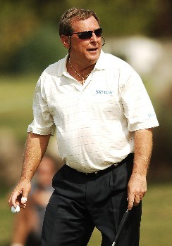 Fuzzy Zoeller acknowledges the gallery after saving par on the 10th green during the first round of the FedEX Kinko's Classic at the Hills Country Club in Austin, Texas April 29, 2005.Photo by Steve Grayson/WireImage.com