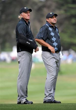SAN FRANCISCO - OCTOBER 08:  Captain Greg Norman and Angel Cabrera of the International Team wait on the sixth fairway during the Day One Foursome Matches of The Presidents Cup at Harding Park Golf Course on October 8, 2009 in San Francisco, California.  (Photo by Harry How/Getty Images)