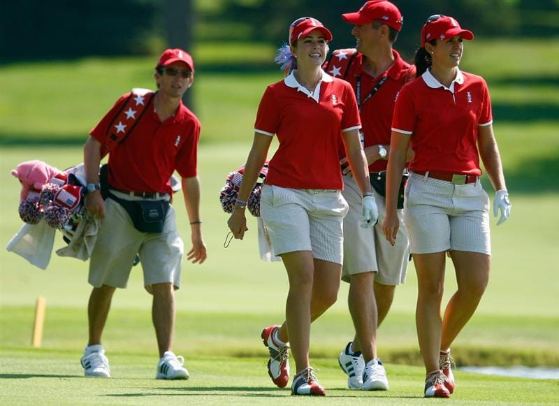 SUGAR GROVE, IL - AUGUST 18:  Paula Creamer (2nd L) and Nicole Castrale (R) of the U.S. Team walk with their caddies down a fairway during a practice round prior to the start of the 2009 Solheim Cup at Rich Harvest Farms on August 18, 2009 in Sugar Grove, Illinois.  (Photo by Scott Halleran/Getty Images)