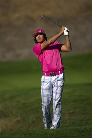SAN MARTIN, CA - OCTOBER 14:  Rickie Fowler makes a shot out of the rough after taking a drop during the first round of the Frys.com Open at the Corde Valle Country Club on October 14, 2010 in San Martin, California.  (Photo by Robert Laberge/Getty Images)