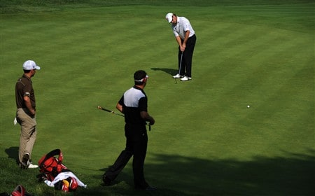 OAKVILLE, ON - JULY 26:  Brian Davis attempts a putt on the second hole as Chez Reavie (left) and Eric Axley look on during the third round of the RBC Canadian Open at the Glen Abbey Golf Club on July 26, 2008 in Oakville, Ontario, Canada.  (Photo by Robert Laberge/Getty Images)