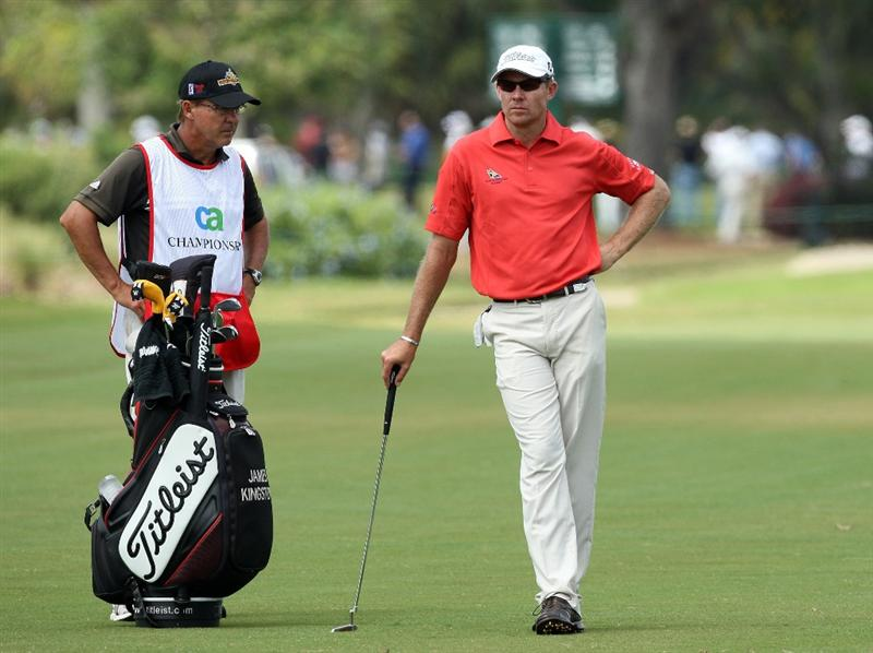 DORAL, FL - MARCH 12:  James Kingston of South Africa chooses his club for his second shot at the 17th hole during the first round of the World Golf Championships-CA Championship at the Doral Golf Resort & Spa on March 12, 2009 in Miami, Florida  (Photo by David Cannon/Getty Images)