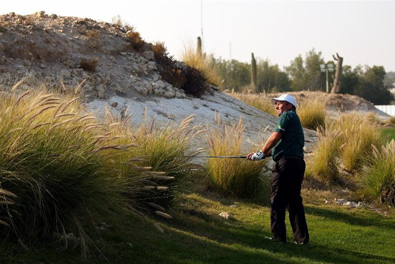 DOHA, QATAR - JANUARY 25:  Damien McGrane of Ireland plays his second shot on the 16th hole during the final round of the Commercialbank Qatar Masters at Doha Golf Club on January 25, 2009 in Doha, Qatar.  (Photo by Andrew Redington/Getty Images)
